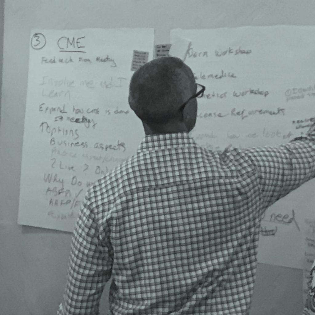 kurt presenting at a white board