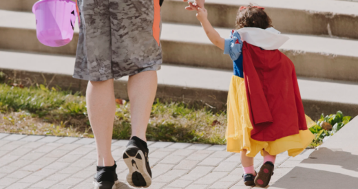 Man trick or treating with his daughter dressed as Snow White