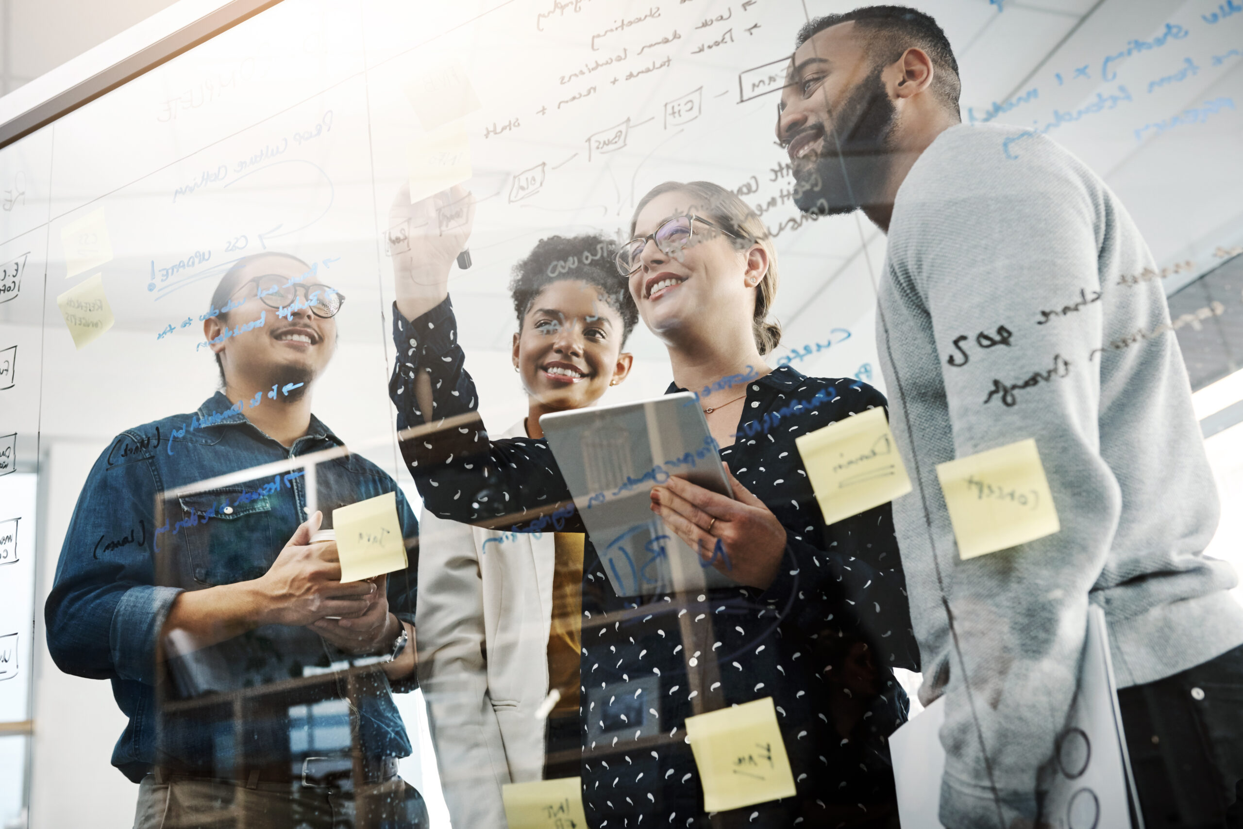 Shot of a group of young businesspeople having a brainstorming session in a modern office