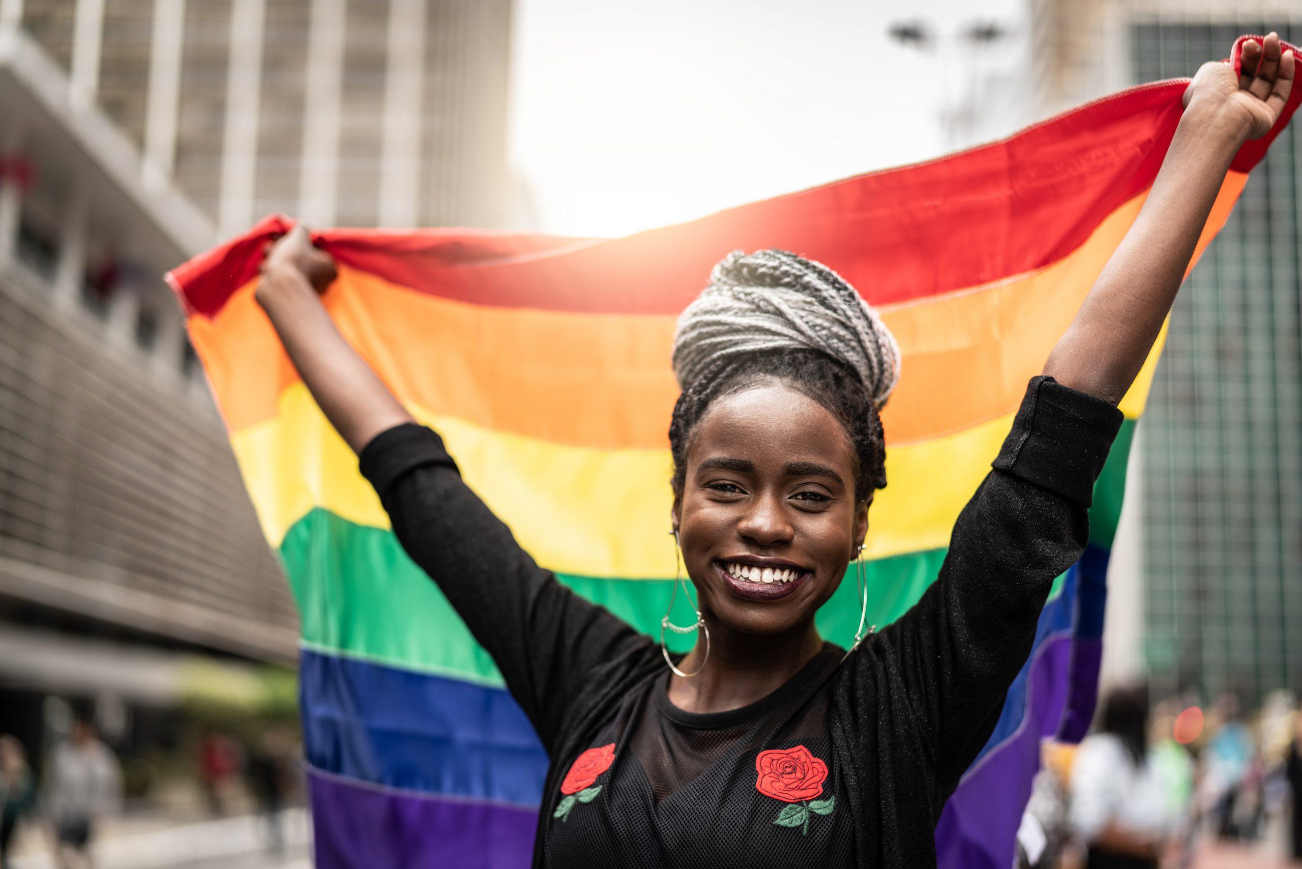 Woman Waving Rainbow Flag at Gay Parade