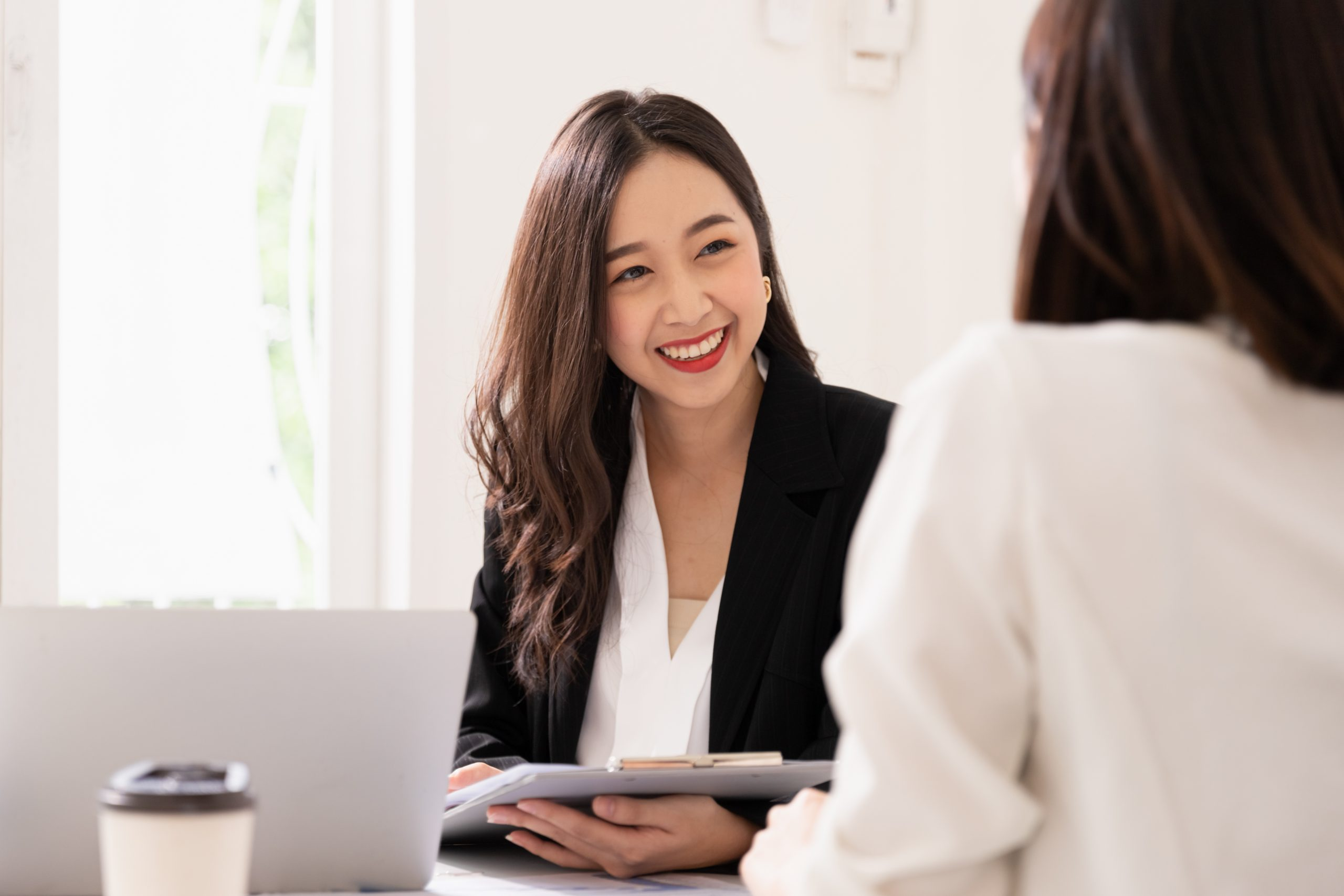 A young asian woman is interviewing for a job. Her interviewers are diverse. Human resources manager conducting job interview with applicants in office