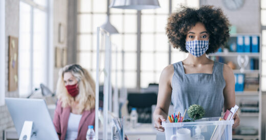 Businesswoman with protective face mask quits job due to limiting workplaces in office, during Covid-19
