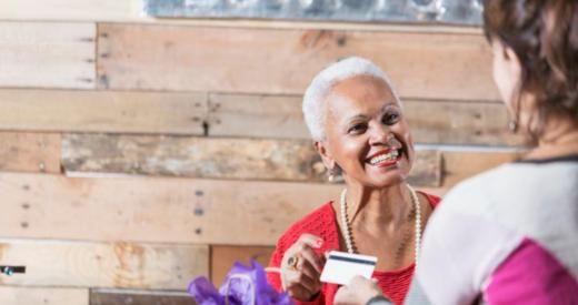 Black woman customer smiling at clerk