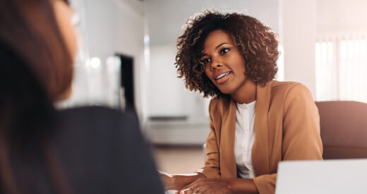 Young woman doing a job interview in the office and talking with client