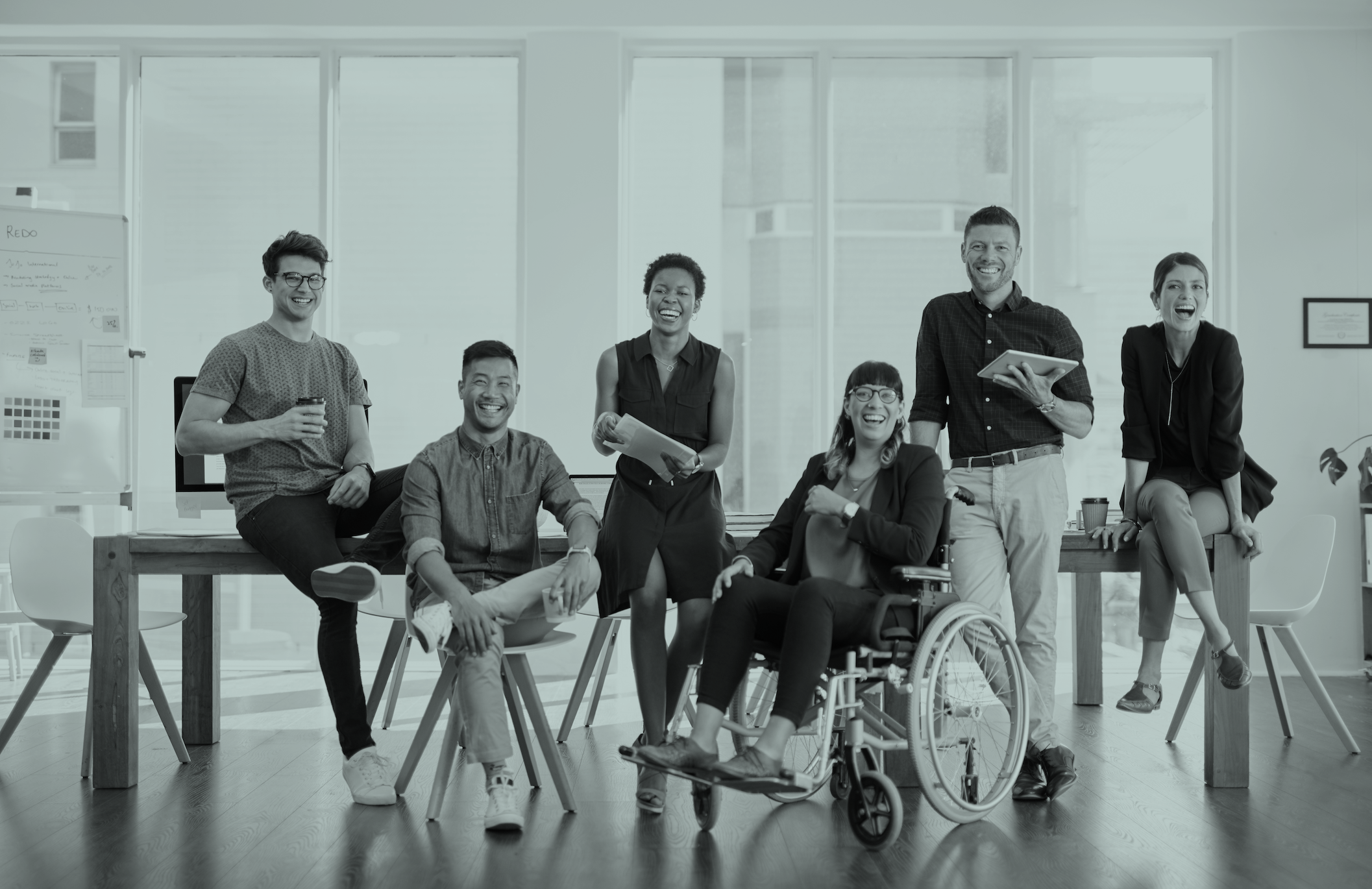 Group of coworkers with and without disabilities smiling together